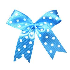 Strikje blauw met witte stippen 4 x 4,5 cm 10 stuks per zakje